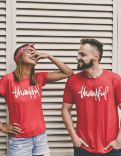 couples meeting - couple wearing shirts that say thankful