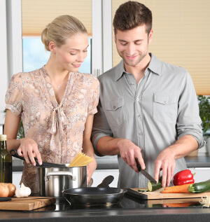 couple's meeting - couple cooking together