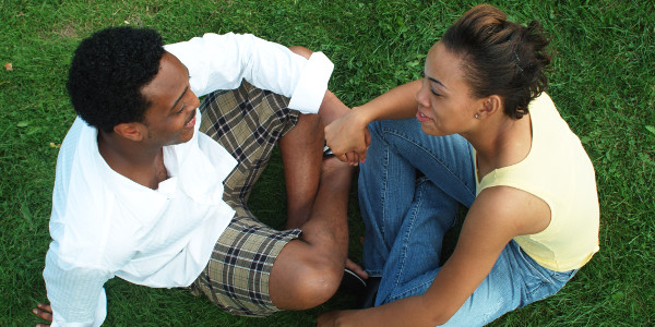 hindrances to communication - young couple holding hands on grass in park