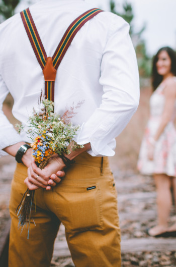 how to be a better husband - man holding flowers behind back