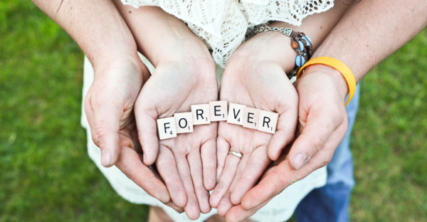 "ground rules marriage - couple holding scrabble letters that spell ""forever"""